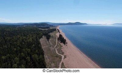 drone flying over the forest near Lake Baikal, Buryatia,...