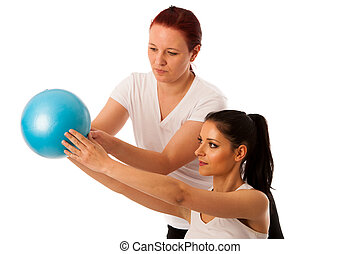 Physiotherapy - therapist doing arm  excercises for improving coordination with a patient to recover  after injury