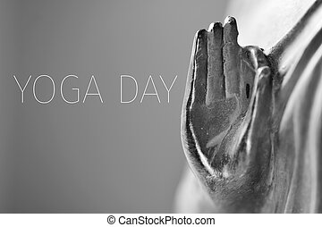 text yoga day and the hand of Buddha - detail of a...