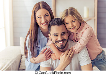 Happy family at home - Portrait of beautiful young mother,...