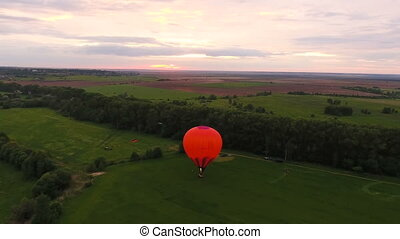Hot air balloon in the sky over a fieldAerial view - Hot air...