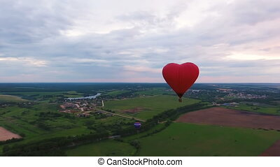 Hot air balloons in the sky over a field.Aerial view - Red...