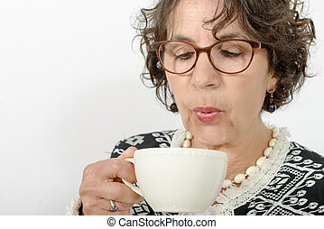 beautiful mature woman drinking tea - a beautiful mature...