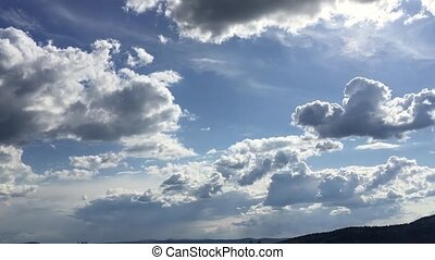 Panoramic of white altocumulus clouds smoke slowly flying in...