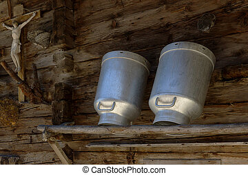 Milk cans - Old milk cans on a shelve at a alpine hut