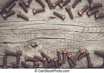 rusty screw bolt on the wooden table - old rusty screw bolts...