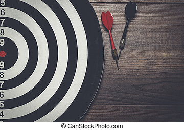 target and two darts on wooden background - target and two...