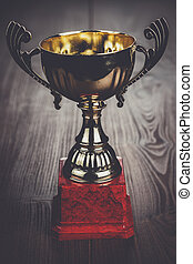 trophy cup the brown wooden table background