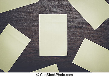 blank stickers on brown wooden table - blank stickers on the...