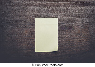 blank sticker on brown wooden table - blank sticker on the...