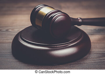 judge gavel on brown wooden table - judge gavel on the brown...