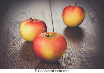 fresh red apples on brown wooden table - fresh red apples on...