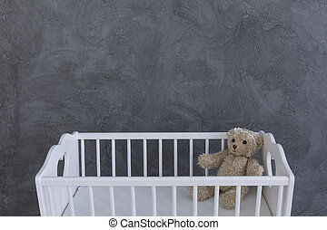 Baby's best friend - Shot of a teddy bear in a crib against...