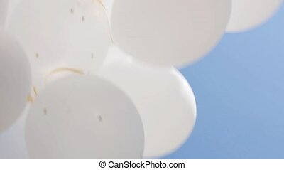 inflated white helium balloons in blue sky 4 - holidays,...