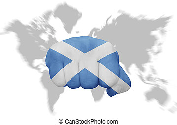 fist with the national flag of scotland on a world map background