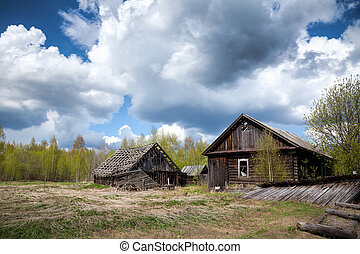 Abandoned wooden house in a deserted village - Old abandoned...