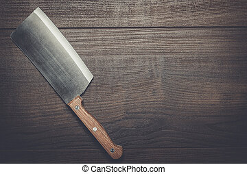 kitchen knife on the brown wooden table