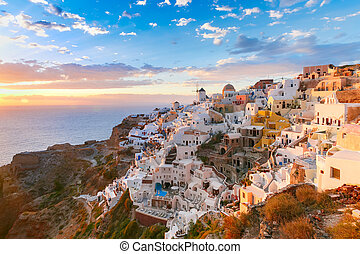 Oia or Ia at sunset, Santorini, Greece - Picturesque view,...