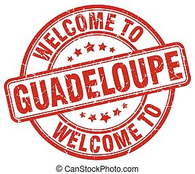 welcome to Guadeloupe red round vintage stamp