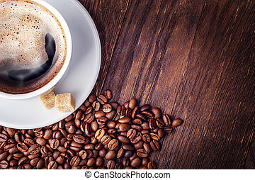 Cup coffee beans wooden dark background