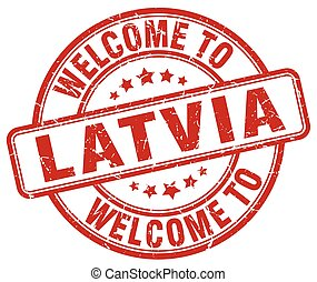 welcome to Latvia red round vintage stamp