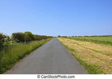 small rural road in summer - a small rural road in the...
