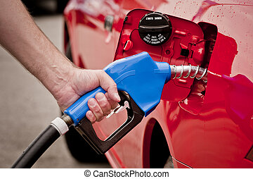 Hand Holding Blue Gas Nozzle - Hand holding blue gasoline...