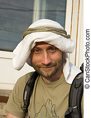 Man in self-made kaffiyeh - Portrait of adult man in...
