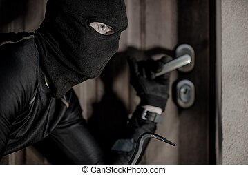 House Burglar in Mask Taking Action. Checking House Doors....