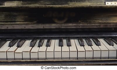 Man walk on piano keyboard by two fingers Musician Sound...