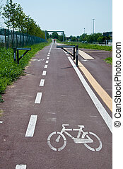 new and long bike path drawn on the ground with the bicycle symbol