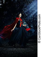 lady in cloak - Beautiful brunette woman in black...