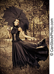 gothic woman - Magnificent brunette woman wearing long black...
