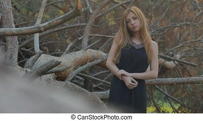 beautiful girl on a background of dry branches - beautiful...