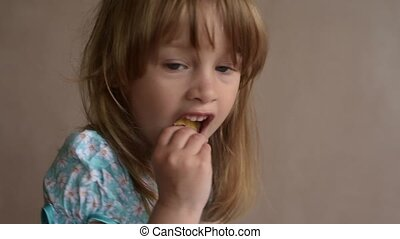 Close up of a girl eating crisps
