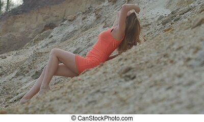 girl in a short dress sexy lying on the sand - blonde girl...
