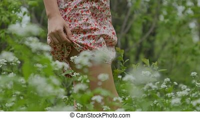 nice legs walking on a grass the girl in the foreground -...