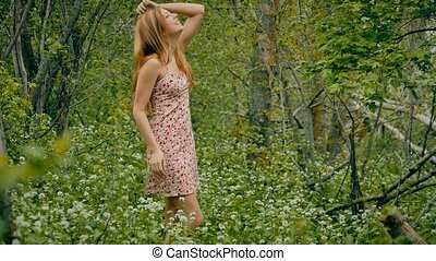girl in a sundress in the forest in spring - blonde girl in...