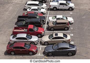 Cars in a parking lot - Aerial view of a parking lot in the...