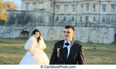Nice couple has a good time at the castle and park