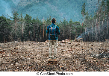 Hiker man standing in the forest - Unrecognizable hiker...