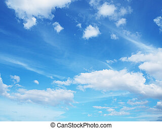 Clear blue sky background with white clouds