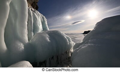 Sunset on freeze ice of the Baikal lake.