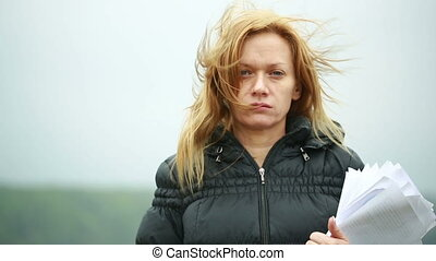 women on strong wind.bad weather. close-up portrait