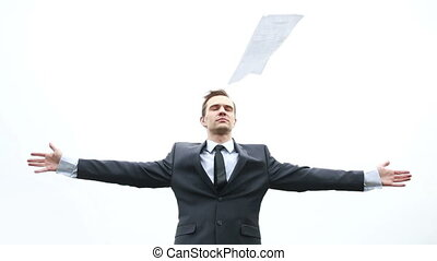 businessman standing on strong wind. it fly documents