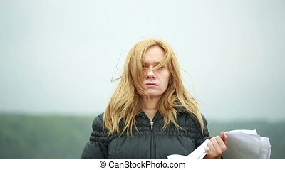 women on strong wind.bad weather