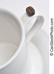 Coffee - A coffee bean and an Empty coffee cup on a saucer...