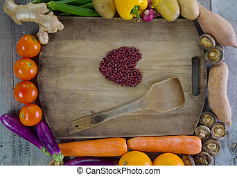 organic food with a blank chopping board on a Wooden...