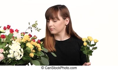 Girl picking flowers in a bouquet. White. Close up - Florist...