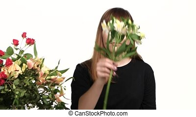 Florist picks flowers from her shop's. Alstroemeria. White....